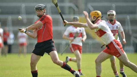Paddy Kelly and Kevin McGarry in action as Derry clinch a place in the Ulster Hurling Final against Antrim