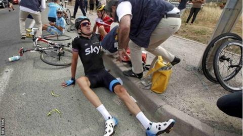 Geraint Thomas after crashing towards the end of the first stage of the Tour