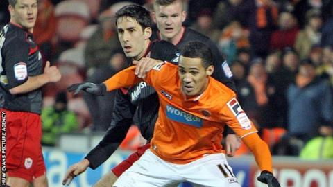 Tom Ince takes on Cardiff City's Peter Whittingham in January, 2013