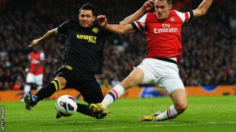 Antolin Alcaraz (left) in action against Arsenal