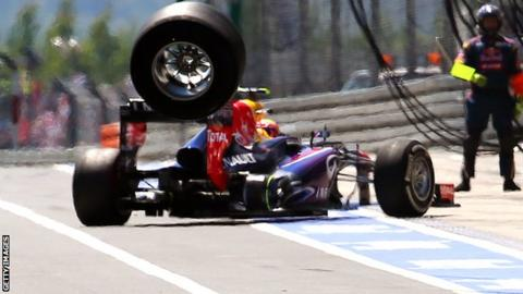 Mark Webber's car loses a wheel