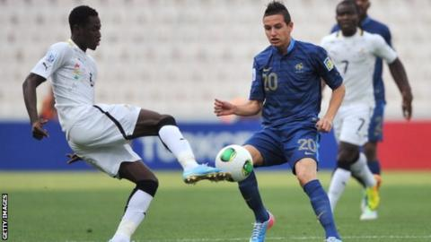 Ghana's Abdul Rahman Baba with France's forward Florian Thauvin