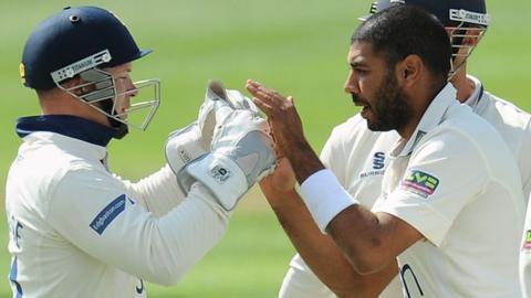 Tim Ambrose congratulates Jeetan Patel