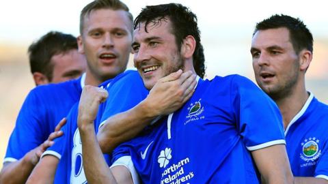 A delighted Michael Gault celebrates after heading Linfield in front