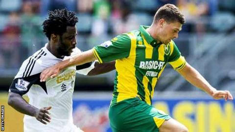 Wilfried Bony (left) makes his Swansea City debut