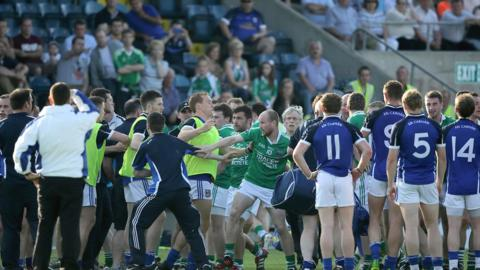 Tempers fray as the players walk off the field at half-time in an ill-tempered encounter