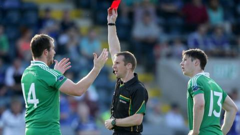 Fermanagh forward Sean Quigley is sent-off by referee Martin Duffy before the start of the second half