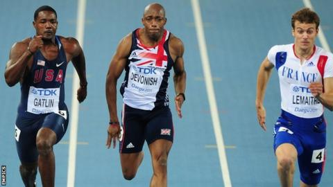Marlon Devonish races alongside Justin Gatlin (left) and France's Christophe Lemaitre (r)