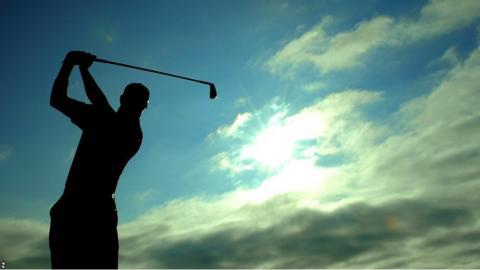 Golfer drives at Muirfield