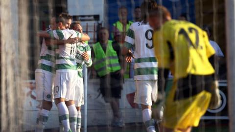 Mikael Lustig celebrates with Celtic team-mates after scoring the opening goal against the Irish Premiership champions