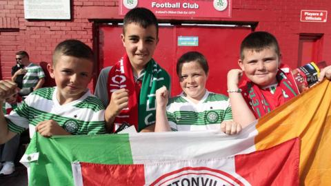 Young fans show off the colours of both teams ahead of Celtic's 3-0 victory over Cliftonville at Solitude