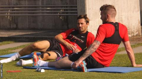 Cardiff City's Tommy Smith and Aron Gunnarsson take a break during training in Lausanne