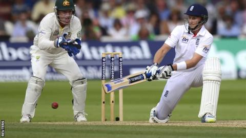 Joe Root reverse sweeps as Brad Haddin looks on