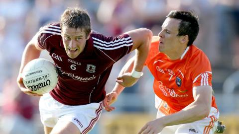 Galway's Gary O'Donnell tries to escape the clutches of Armagh's Mark Shields at Salthill