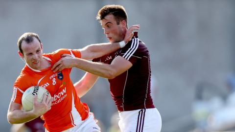 James Lavery shrugs off Paul Conroy during Armagh's defeat by Galway