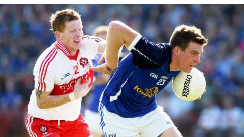 Enda Lynn and Tomas Corr tangle as Cavan beat Derry after extra-time in a close encounter at Celtic Park