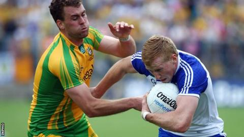 Donegal defender Eamon McGee attempts to halt outstanding Kieran Hughes at Clones