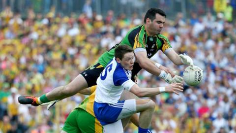 Donegal goalkeeper Paul Durcan reaches the ball ahead of Conor McManus during Monaghan's victory in the senior final