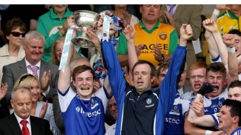 Monaghan minor captain Kevin Loughran collects the cup after his side mount a stunning comeback against Tyrone