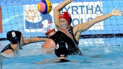Canada's Christine Robinson (c) score against Britain's Michele Relton
