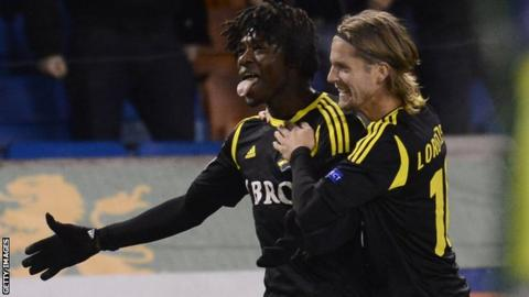Mo Bangura (left) celebrates scoring for AIK
