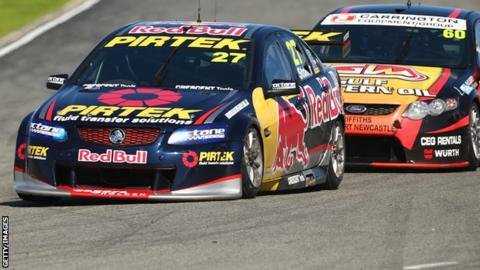 Casey Stoner (number 27) drives his Red Bull Pirtek Holden during race two of round two in the V8 Supercars Dunlop Development Series in Perth, Western Australia