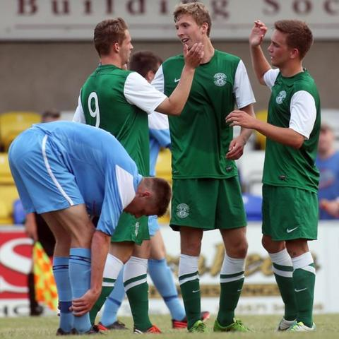 Hibernian players celebrate their third goal in the Under-19 match against Institute