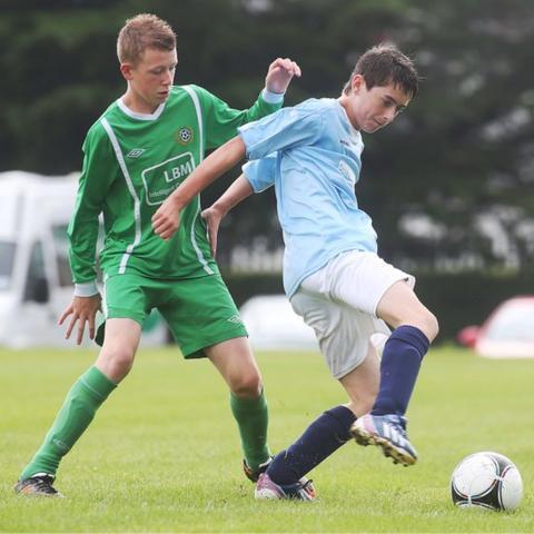Shankill's Kyle Ferguson contests possession against Nathan Beckett of Enniskillen Town