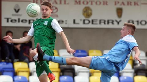 Hibernian's Jay Doyle attempts to get to the ball before Niall Logue of Institute during the Under-19 match at Drumahoe