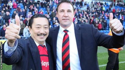 Vincent Tan and Malky Mackay give the thumbs-up to the camera