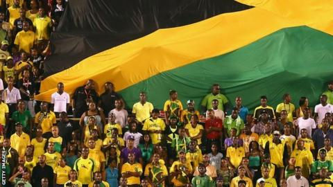 Jamaica fans watch their team play