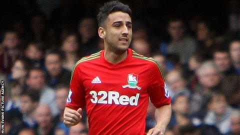 Neil Taylor playing for Swansea on his return from injury