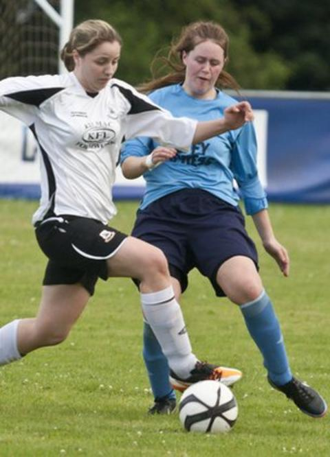 Lagan's Nadine Crawford battles with Kilmacrennan's Roisin Friel in the Foyle Cup