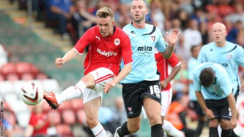 Craig Noone fires a shot at goal as Cardiff City continued their preparations for the Premier League season with a 1-1 draw at Cheltenham Town.