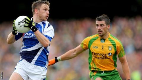 Ross Munnelly of Laois in possession against Paddy McGrath of Donegal