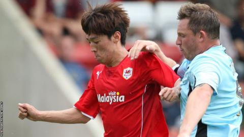 Cardiff are indebted to midfielder Kim Bo-Kyung who rescues a draw at Cheltenham with the equaliser