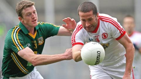 Meath's Kevin Reilly challenges Tyrone forward Stephen O'Neill