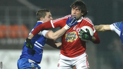 Monaghan's Shane McQuillan tackles Justin McMahon of Tyrone