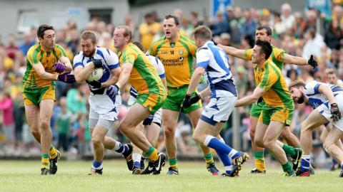 Donegal pair Rory Kavanagh and Neil Gallagher tackle Billy Sheehan in the qualifier against Laois at Carrick-on-Shannon