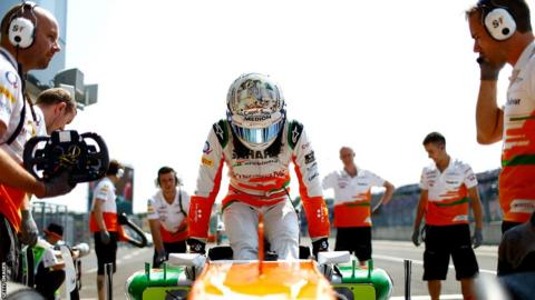 Adrian Sutil steps out of his Force India car