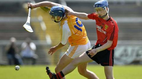 Antrim's Jordan Doran is challenged by Down opponent Cormac MacAllister in last month's Ulster final