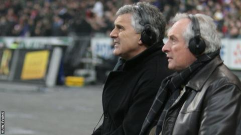 Gareth Davies (left) alongside Gareth Edwards while working as a television pundit