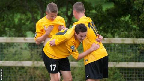 County Antrim celebrate after Ryan Caulfield's opening goal in their 4-0 Junior win over Ipswich on Wednesday