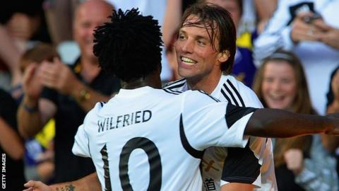 Swansea goal-scorers Wilfried Bony and Michu celebrate