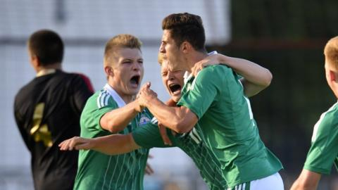 Cameron McGeehan celebrates after giving Northern Ireland the lead in their 2-1 defeat by Mexico at Ballymena Showgrounds