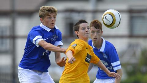 Everton's James Yates and County Antrim's Ryan Caulfield vie for possession during the Junior decider