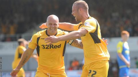 Harry Worley (right) celebrates with captain David Pipe after giving Newport the lead against Accrington Stanley at Rodney Parade.