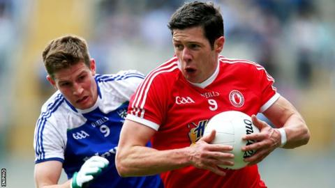 Sean Cavanagh tries to burst away from Darren Hughes at Croke Park