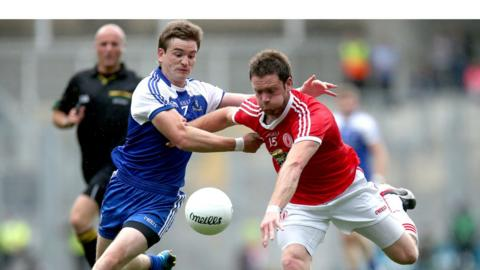 Dessie Mone challenges Martin Penrose during Tyrone's win over Monaghan in the first All-Ireland quarter-final