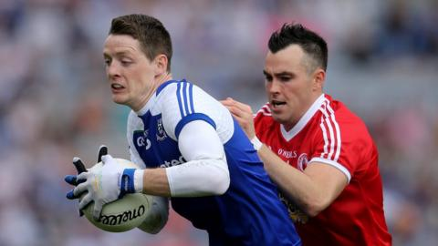 Conor Hughes and Cathal McCarron in action during the Ulster derby in Dublin